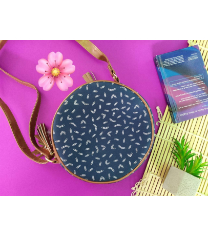 Handcrafted Round Shaped Fabric Sling Bag With Staple Print